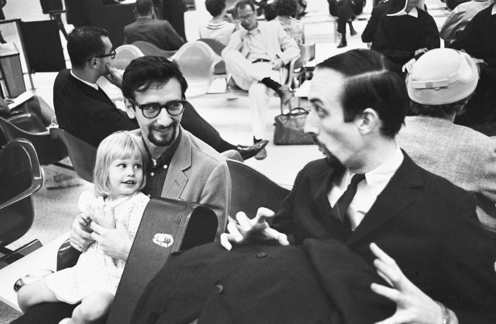 Noel and Peter play a game with Mary's daughter Erika, then age two.