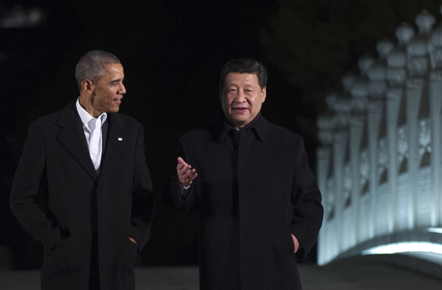 "US President Barack Obama (L) walks with China's President Xi Jinping at the Zongnanhai leaders compound on November 11, 2014. The summit of Asia-Pacific leaders supported a China-backed ""roadmap"" towards a vast free trade area."