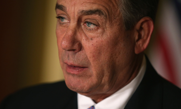 Speaker of the House John Boehner (R-OH) talks with reporters in his office in the U.S. Capitol.