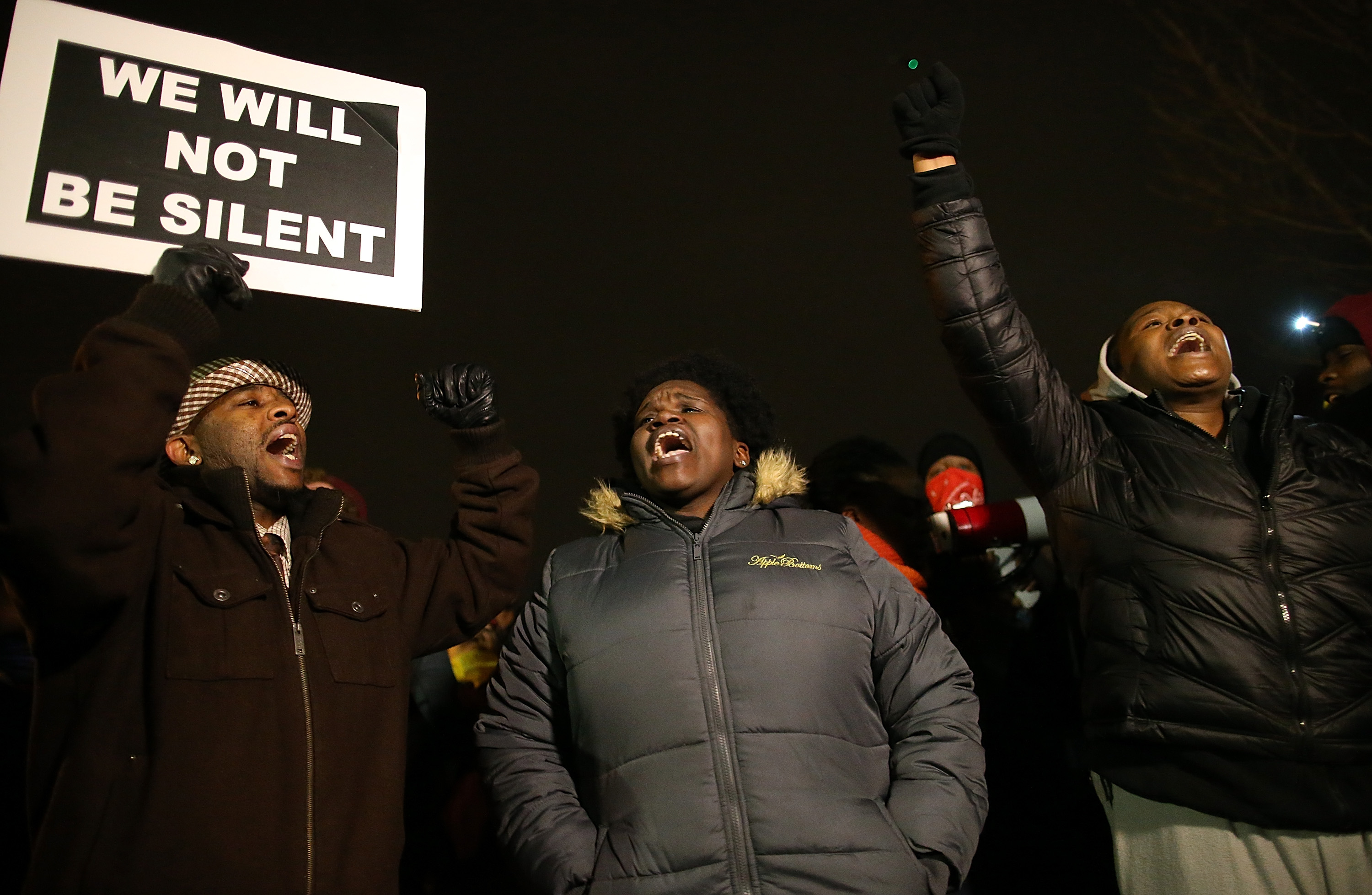 Demonstrators block traffic as they protest in front of the Ferguson police department on November 24, 2014 in Ferguson, Missouri. A St. Louis County grand jury has decided to not indict Ferguson police Officer Darren Wilson in the shooting of Michael Brown.