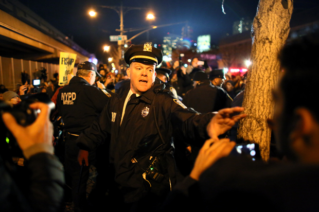Police clash with protesters on the West Side Highway December 3, 2014 in New York. Protests began after a Grand Jury decided to not indict officer Daniel Pantaleo. Eric Garner died after being put in a chokehold by Pantaleo on July 17, 2014.