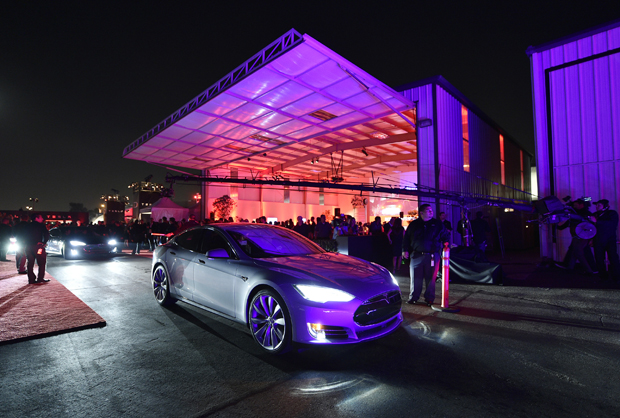 "Tesla owners take a ride in the new Tesla ""D"" model electric sedan after Elon Musk, CEO of Tesla, unveiled the dual engine chassis of the new Tesla 'D' model, a faster and all-wheel-drive version of the Model S electric sedan, Oct. 9, 2014 in Hawthorne, California. The D will be able to accelerate to 60 miles per hour in just over 3 seconds."