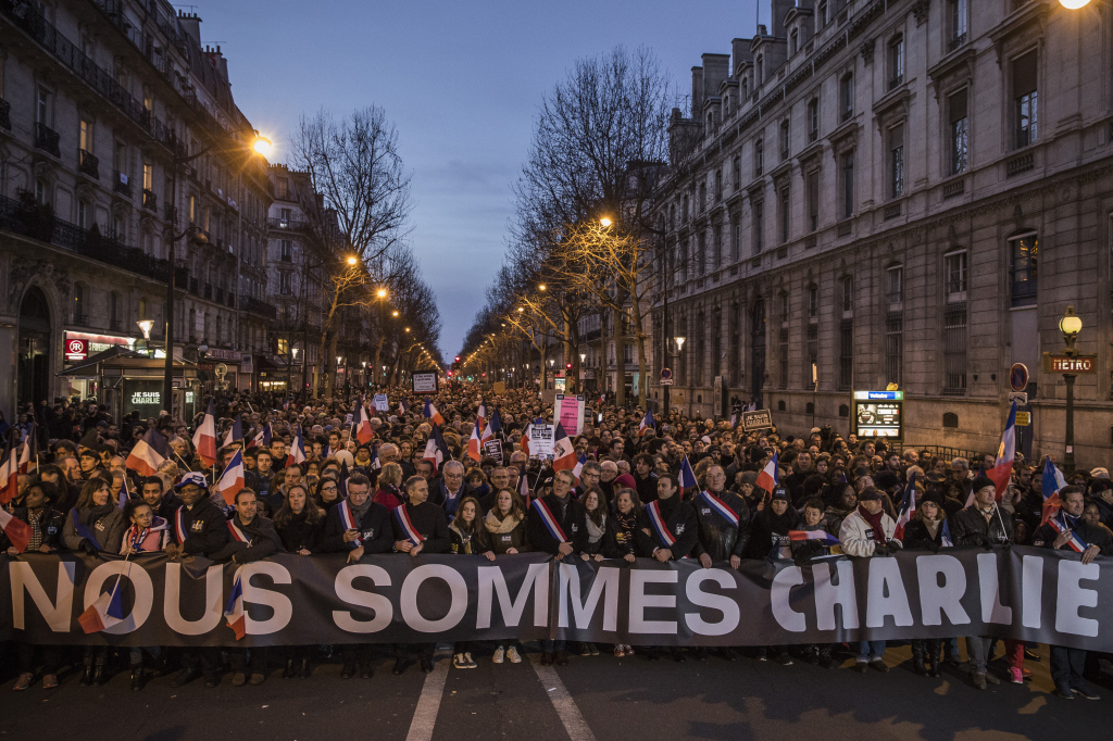 Demonstrators make their way along Place de la Republique during a mass unity rally following the recent terrorist attacks on January 11, 2015 in Paris, France. An estimated one million people converged in central Paris for the Unity March  in solidarity with the 17 victims of this week's terrorist attacks in the country.