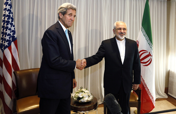 Iranian Foreign Minister Mohammad Javad Zarif shakes handswith U.S. State Secretary John Kerry on Jan. 14 in Geneva. Kerry was preparing Feb. 22 to sit down for two days of talks with Zarif, whose country denies its nuclear program has military objectives.