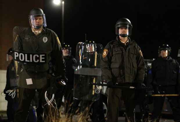 This file photo from November 2014 shows St. Louis County police officers in riot gear, standing guard in front of the Ferguson police department after a grand jury decided to not indict Ferguson police Officer Darren Wilson in the shooting of Michael Brown.
