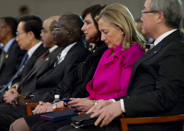 This 2011 file photo shows Secretary of State Hillary Clinton checks her Blackberry phone alongside Korean Foreign Minister Kim Sung-hwan (R) as she attends the Fourth High Level Forum on Aid Effectiveness in Busan, Korea.