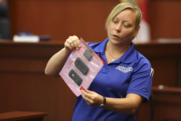 A crime scene technician for the Sanford Police Department shows the jury a cell phone that was collected as evidence for George Zimmerman's 2013 trial in Sanford, Florida.