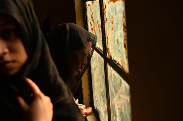 Shiite Muslim women watch an Ashura procession on November 4, 2014.