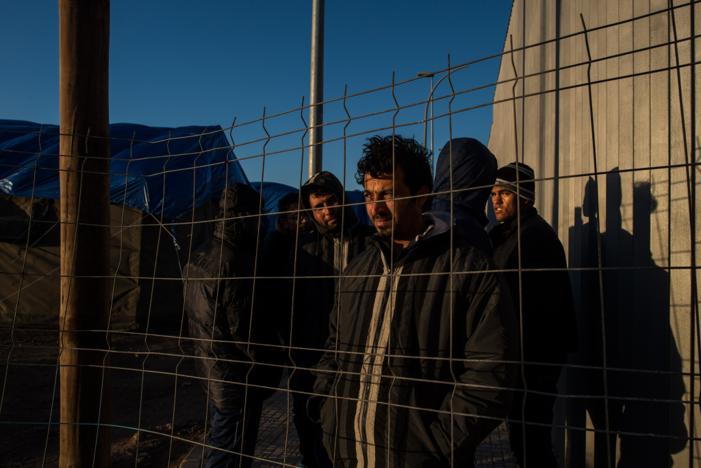 A Syrian refugee from Kobani looks through the fence at the Temporary Inmigrant Centre (CETI) on January 22, 2015 in Melilla, Spain.