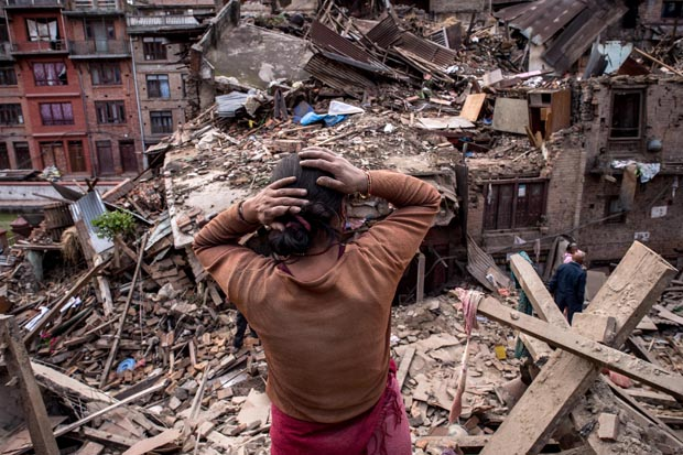 A Nepalese earthquake victims looks on April 29 at debris of collapsed buildings in Bhaktapur, Nepal.