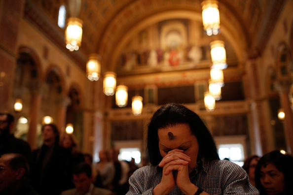 Jan Ali prays during Ash Wednesday Mass at the Cathedral of St. Matthew the Apostle in Washington, D.C.