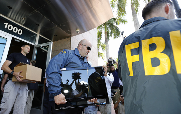 FBI agents carry boxes and computers from the headquarters of CONCACAF after it was raided May 27 in Miami Beach, Florida. The raid is part of an international investigation of FIFA.