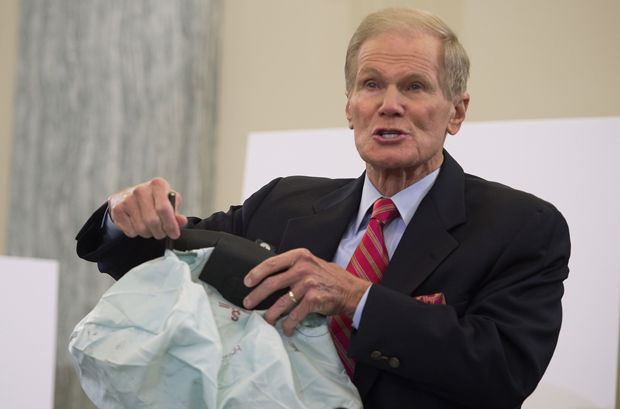In this Nov. 2014 photo, Bill Nelson, D-FL, holds up a defective airbag during a hearing on Takata airbag defects in Washington, D.C. Takata this week doubled the number of vehicles that need to be recalled.