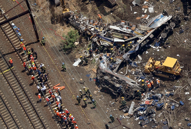 Investigators and first responders work near the wreckage of an Amtrak passenger train that derailed May 13 while carrying more than 200 passengers from Washington, D.C. to New York.
