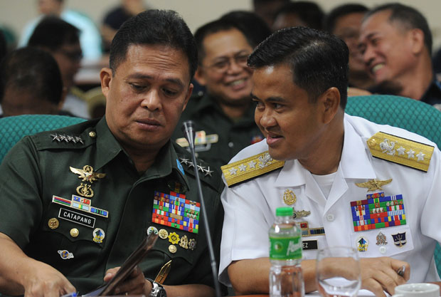 Gen. Gregorio Pio Catapang, Chief of Staff of the Armed Forces of the Philippines, talks to Vice Admiral Alexander Lopez during a Senate Inquiry of the disputed islands at the South China Sea in Manila