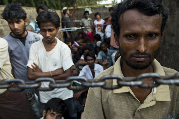 Rohingya men from Myanmar are transported after they were rescued May 20 off the coast of Indonesia.
