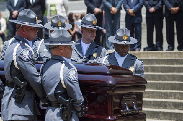The South Carolina Highway Patrol Honor Guard arrives June 24 with the coffin of church pastor and South Carolina State Sen. Clementa Pinckney at the Statehouse in Columbia, South Carolina.