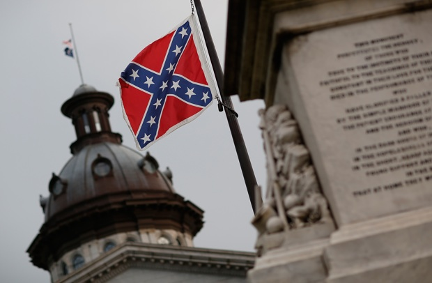 The Confederate flag flies on the grounds of South Carolina's capitol June 23, one day after South Carolina Gov. Nikki Haley announced that she will call for the Confederate flag to be removed.