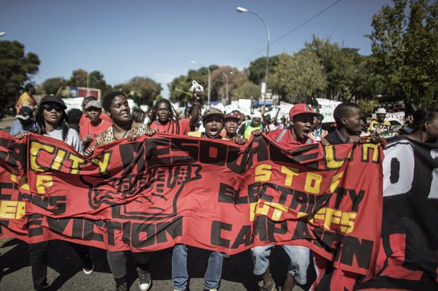 Hundreds of demonstrators march May 15 to the French Consulate to demand the French government and French company Engie stop supporting coal in South Africa and support sustainable renewable energy instead.