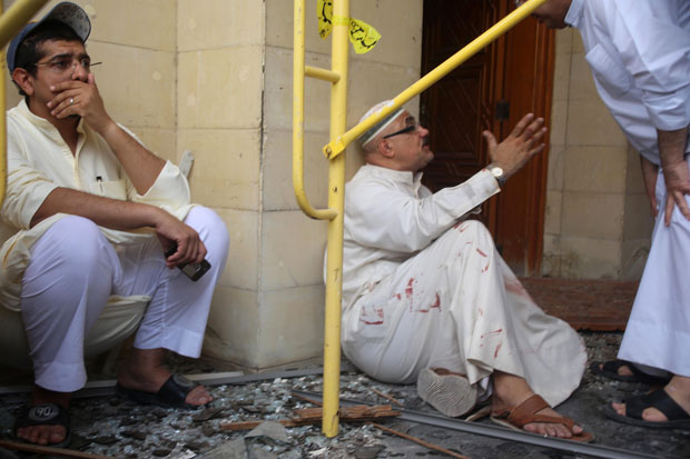 Kuwaiti men react at the site of a June 26 suicide bombing that targeted the Shiite Al-Imam al-Sadeq mosque during Friday prayers in Kuwait City.