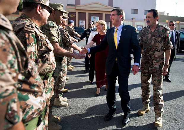 U.S. Defense Secretary Ash Carter is greeted July 22 by Gen. Mashal al-Zaben (R) and members of the Jordanian Armed Forces as he arrives at the Jordan Armed Forces General Headquarters in Amman, Jordan.
