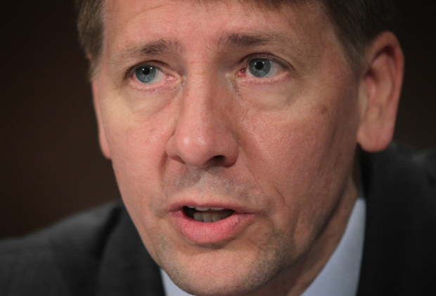 This 2014 photo shows Consumer Financial Protection Bureau Director Richard Cordray testifying during a hearing before Senate Banking, Housing and Urban Affairs Committee on Capitol Hill in Washington, D.C.