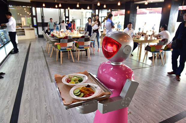 A female robot waiter delivers meals for customers May 18 at a robot-themed restaurant in the Yiwu, Zhejiang province of China.