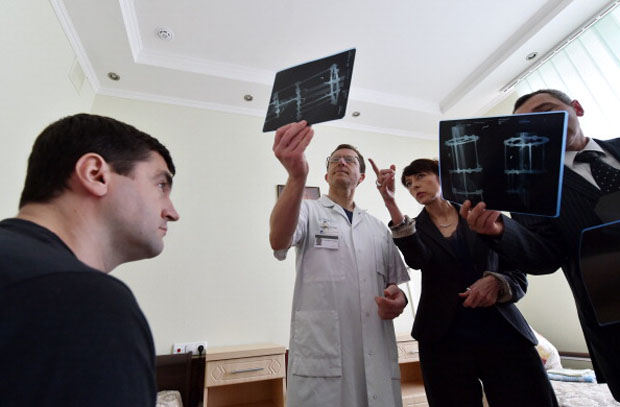 Doctors examine x-rays of a patient.