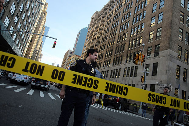 Police cordon off a crime scene where two people were shot Aug. 21 in New York City.