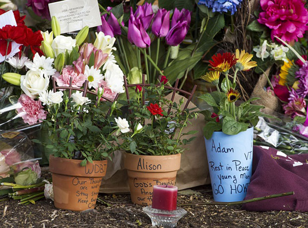 "A makeshift memorial is viewed at the gate of WDBJ's television studios August 27 in Roanoke, Virginia.  The former television reporter who shot dead two journalists during a live broadcast before killing himself warned he had been a ""human powder keg... just waiting to go BOOM."""