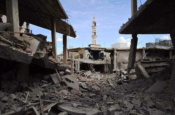 A picture taken  Sept. 30, shows buildings and a minaret damaged by Russian airtstrikes in the central Syrian town of Talbisseh in the Homs province.