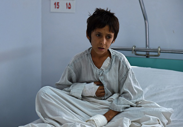 A wounded Afghan boy, who survived the U.S. airstrikes on Doctors Without Borders at the MSF Hospital in Kunduz, sits on his bed at the Italian aid organization Emergency in Kabul.