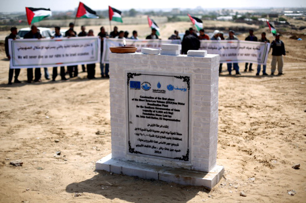 This 2014 file photo shows the first stone to mark the start of the construction of a major seawater desalination plant, which has a capacity of 6000 m3 of water per day, in the central Gaza Strip.