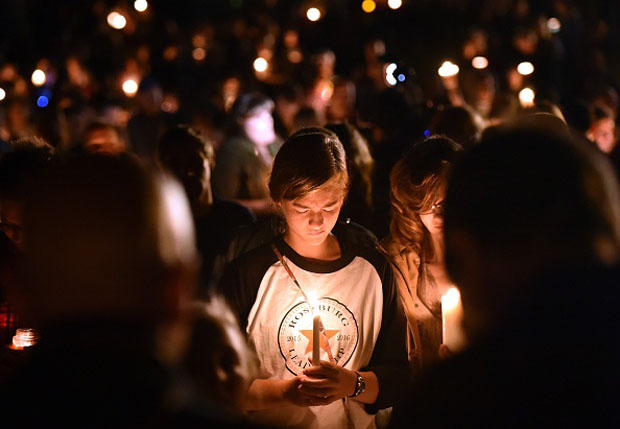 A girl prays during a vigil Oct. 1 in Roseburg, Oregon. Ten people  were killed and seven others were wounded in a shooting at a community college.