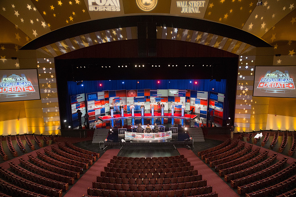 Workers test the setup at the Milwaukee Theater for Tuesday night's Republican presidential debate sponsored by Fox Business News and the Wall Street Journal.