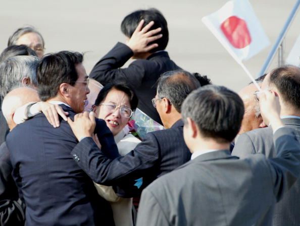 Fukie Hamamoto, abducted to North Korea in July 1978, hugs her family at Haneda Airport Oct. 15, 2002, in Tokyo upon arriving on Japanese soil for the first time in 25 years for a temporary visit.