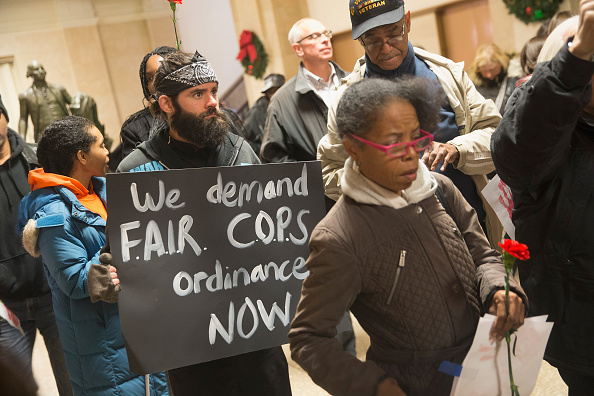 Demonstrators protest Tuesday outside the office of Chicago Mayor Rahm Emanuel at City Hall after the mayor announced the firing of Police Superintendent Garry McCarthy.