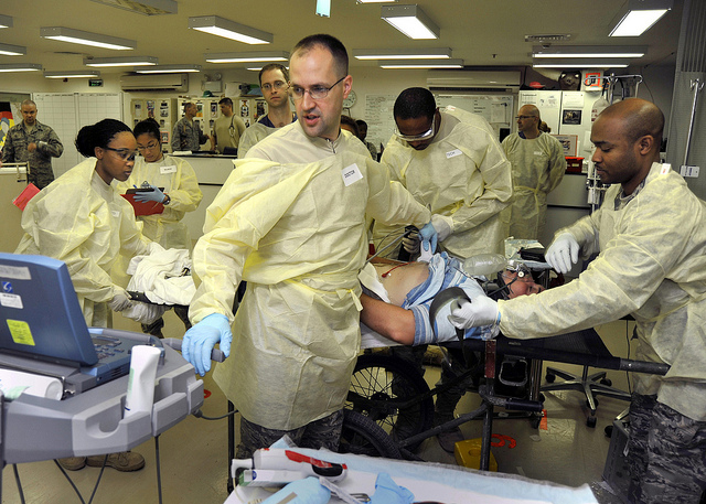 Medical personnel simulate emergency treatment during a mass casualty exercise at Balad's Air Force Theater Hospital.