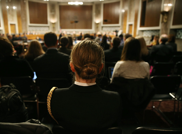 U.S. Navy LCDR Stephanie Hayes listens to testimony about women in the military during a Senate Armed Services Committee hearing on Capitol Hill, February 2 in Washington, DC.