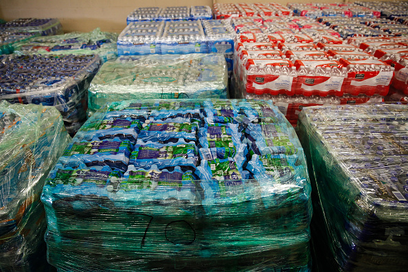 Cases of bottled water are shown at a fire station on February 7 in Flint, Michigan. Months ago the city told citizens they could use tap water if they boiled it first, but now say it must be filtered to remove lead.