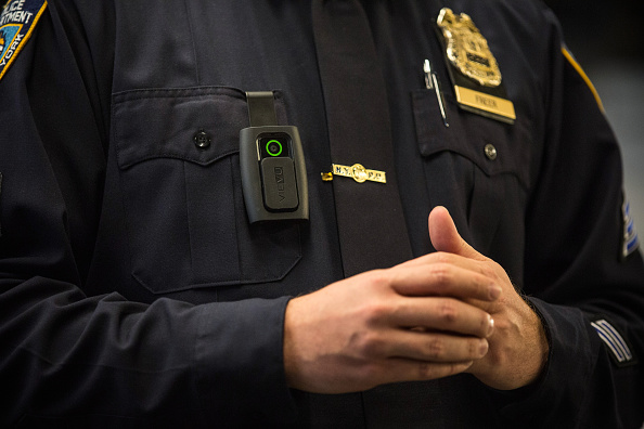 New York Police Department (NYPD) Sergeant Joseph Freer demonstrates how to use and operate a body camera during a media press conference on December 3, 2014 in New York City.