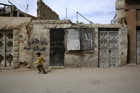 A Syrian boy walks in the al-Qaboun rebel-held northeastern suburb of the capital Damascus on March 13, 2016. One in three Syrian children have known nothing but a lifetime of war, UNICEF said, as the country's conflict enters its sixth year this week.