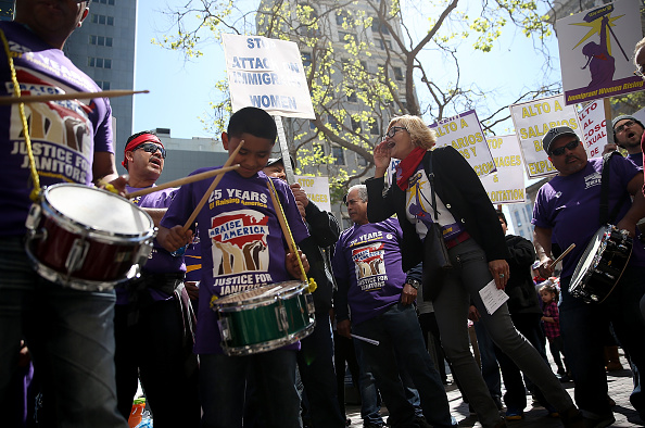 Union and fast food workers play drums during a demonstration in support of a proposal to raise the California minimum wage to $15 by 2022 on March 31 in Oakland, California. The proposal has since been signed into law by Governor Jerry Brown.