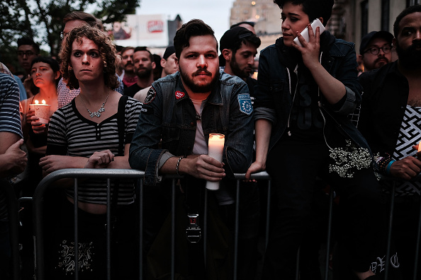 Hundreds of people listen to speakers at a memorial gathering June 13 in New York for those killed in the shooting at a gay nightclub in Orlando.