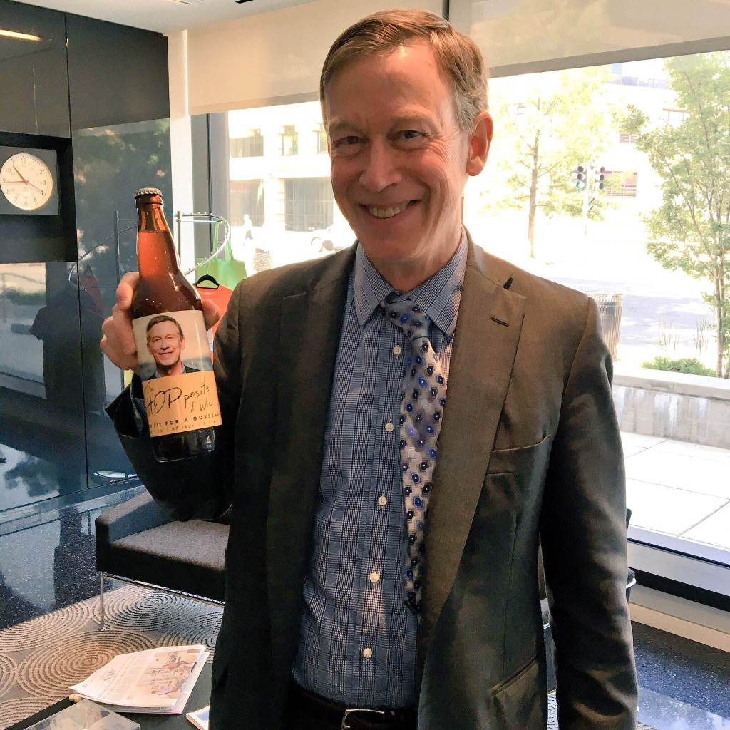 Gov. John Hickenlooper shows off the beer — The Hoppisite of Woe —  brewed for the release of his book before our May 25 show .