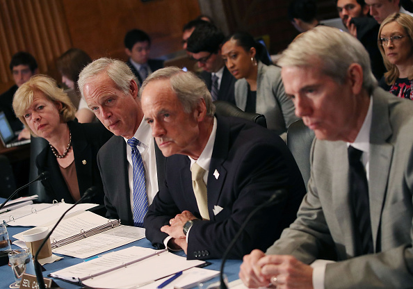 Sen. Tammy Baldwin (D-WI), Chairman Ron Johnson (R-WI), Sen. Tom Carper (D-DE), and Sen. Rob Portman (R-OH) (L to R) listen to statements during a Senate Homeland Security and Governmental Affairs Committee round table discussion on the Zika Virus, June 29 in Washington, DC.