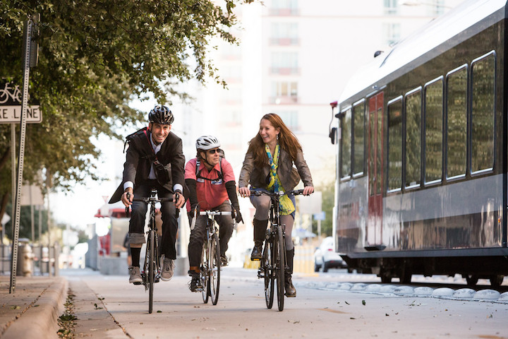Bike commuters use a protected lane in Austin, Texas.