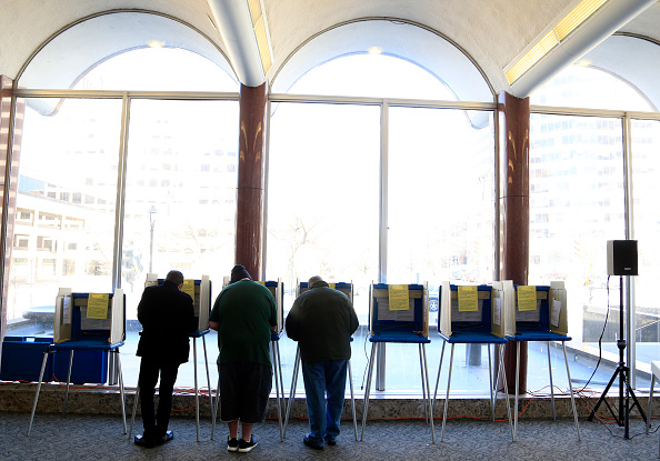 Voters take to the polls April 5 at Milwaukee City Hall in Milwaukee, Wisconsin.  A federal judge ordered the state last week to rewrite its voter ID rules.