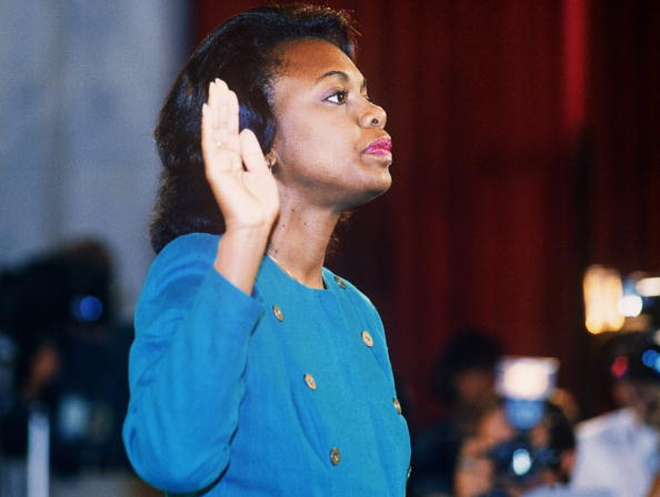 Law professor Anita Hill takes oath on October 12, 1991, before the Senate Judiciary Committee. Fellow professor Emma Coleman Jordan served as legal support for Hill as she filed sexual harassment charges against U.S. Supreme Court nominee Clarence Thomas.