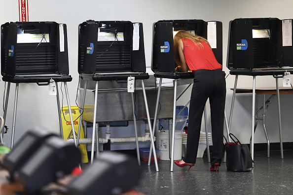 A voter fills out their ballot as they vote in the Florida primary on August 30 in Miami, Florida.